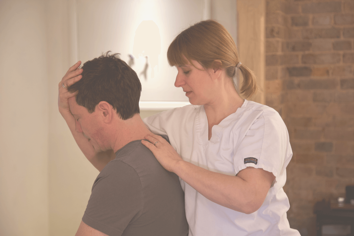Anna Shawcross treating patient for neck pain